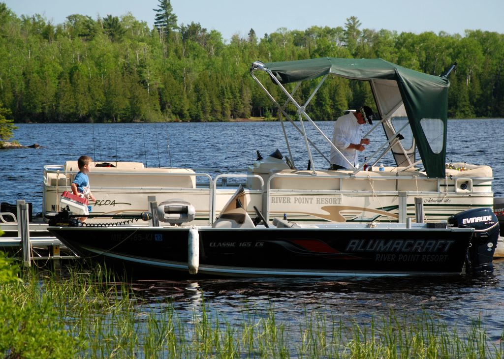 Ely Minnesota Hotels Motels-Pontoon Boat at River Point Resort-Birch Lake